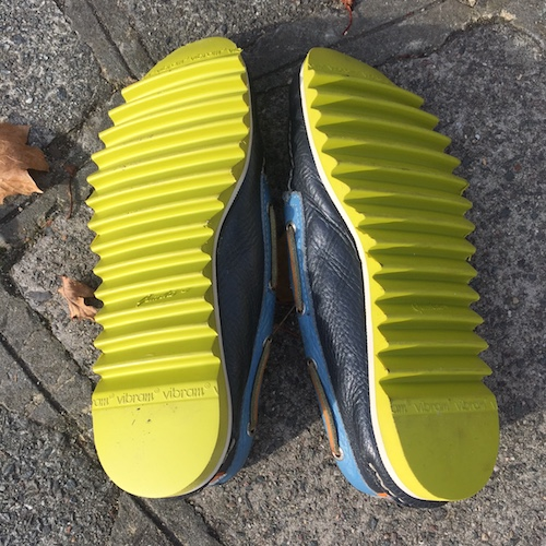 Green Vibram sole shoe factor old street